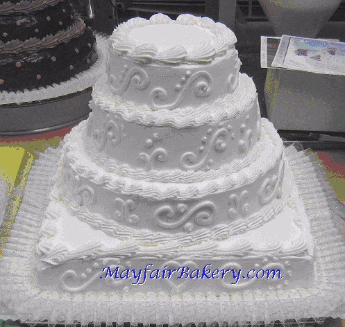 square wedding cake with round tiers