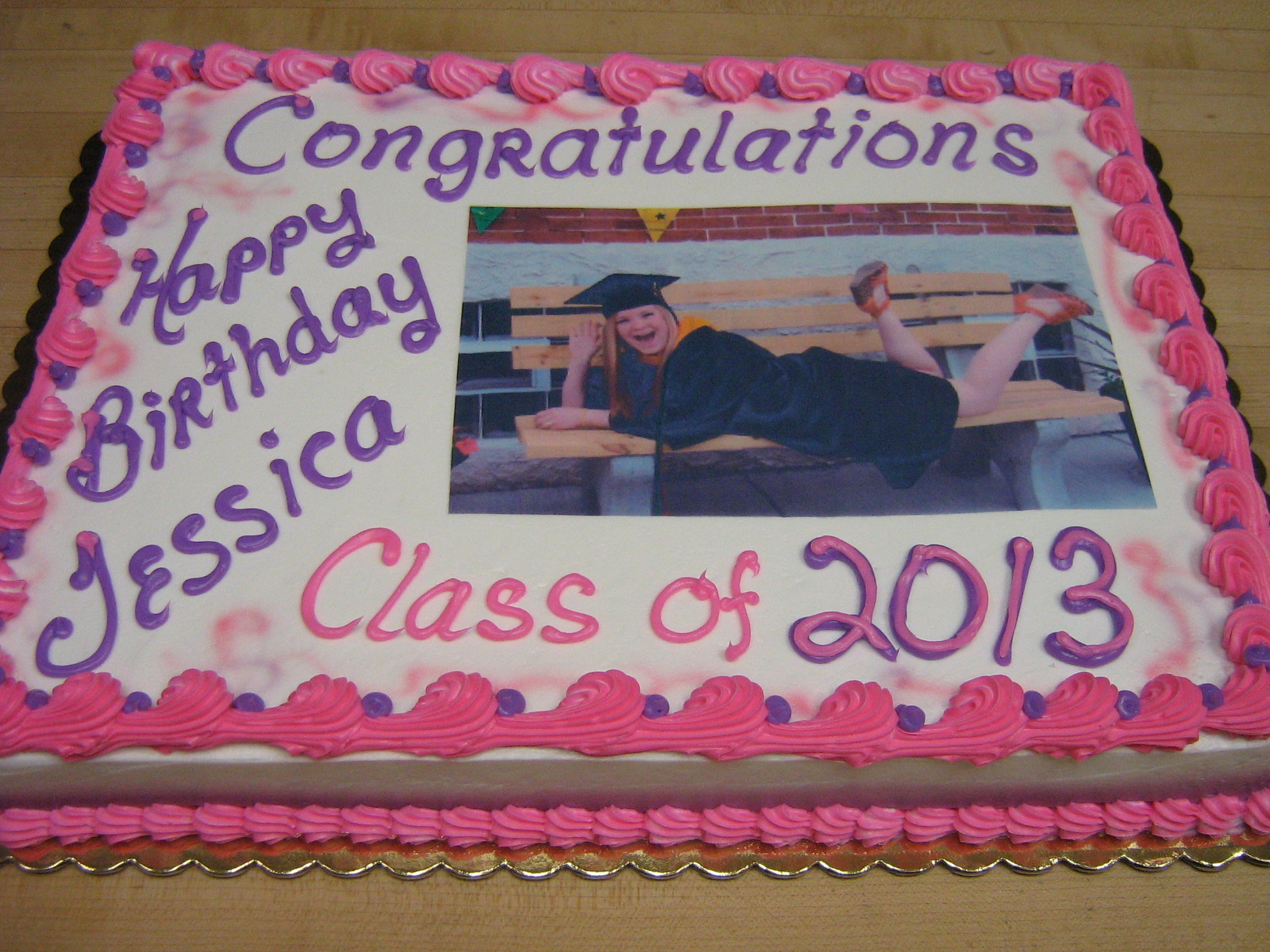 Full sheet graduation cake in pink and purple with edible kopyjet picture.