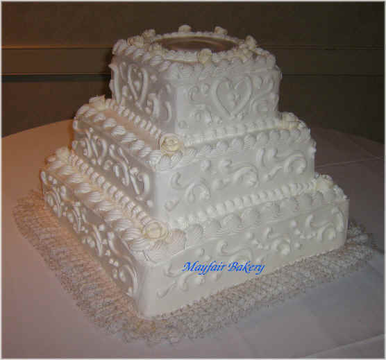 Three tier square wedding cake by Mayfair Bakery
