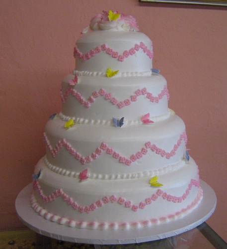 4 tier cake with sugar butterflies