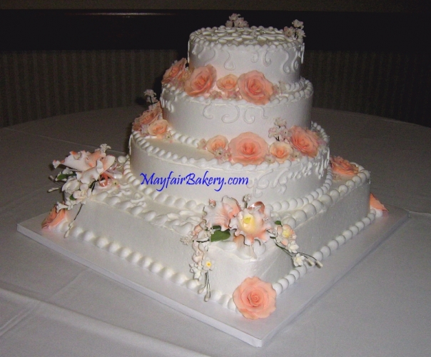 4 tier with peach flowers